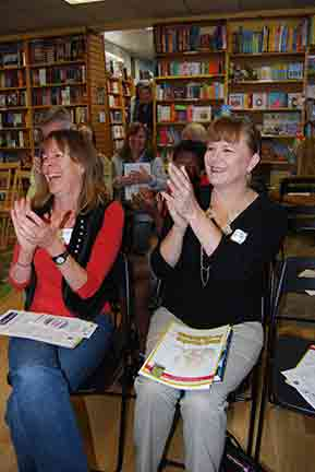 Jean Reagan and Kim Williams-Justesen clap for Bobby Pyron