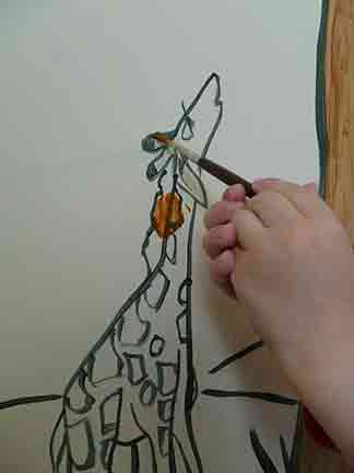Painting the baby giraffe